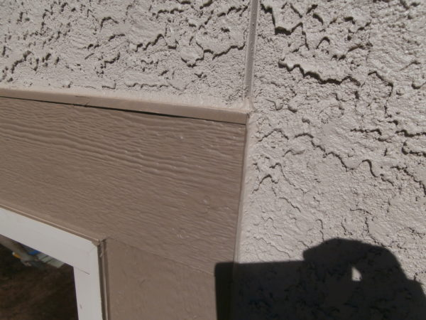 Stucco flashing should not be sealed above window